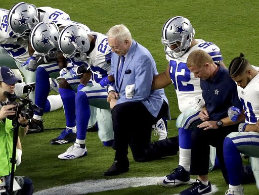 Jerry Jones with his players before the National Anthem Photo credit:AP